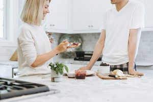 A picture of a man and woman in a kitchen