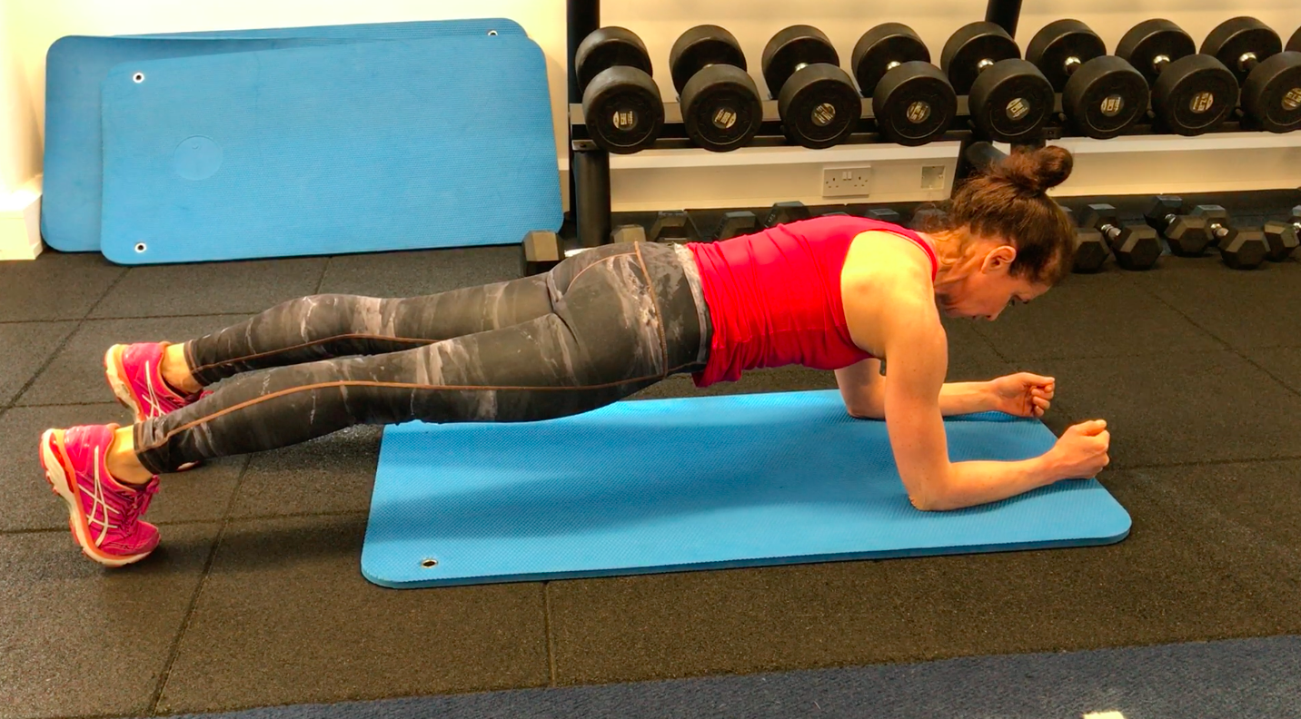 A picture of our trainer, Samantha, performing one of the exercises to improve posture, The Plank