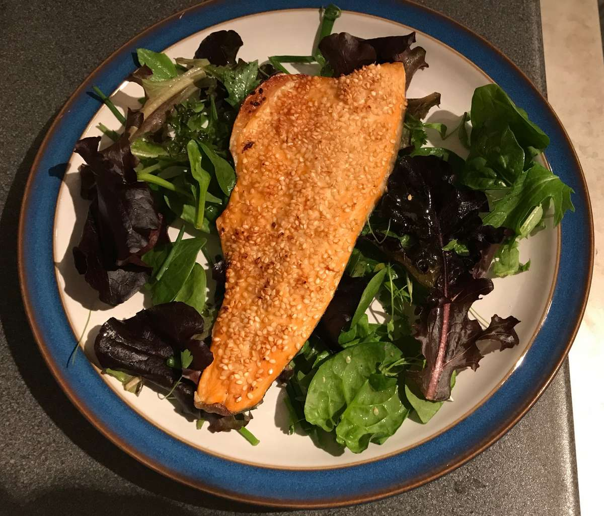 Should you become a pescatarian? Sesame Trout served on a bed of herb salad leaves