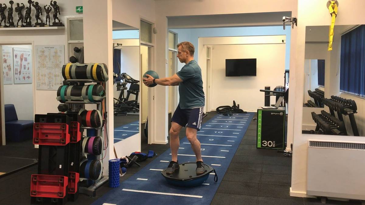 Static Balance Progressions: Standing stance, torso rotations on BOSU. This is a more advanced drill in the static balance progressions