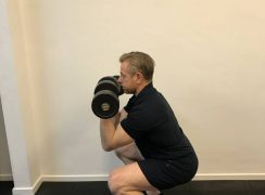 At home conditioning dumbbell workout. Coach doing front squats