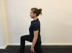 Basic bodyweight workout. Coach performing bodyweight lunges